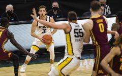 Iowa guard Jordan Bohannon looks to pass during a men's basketball game between Iowa and Minnesota on Sunday.