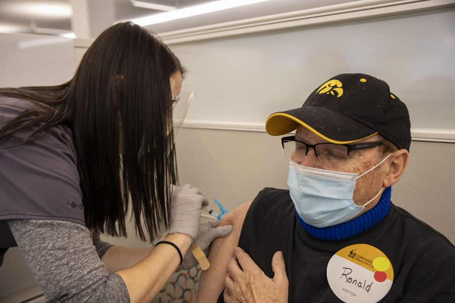 Community vaccinations given on Wednesday, Feb. 3, 2021. Ronald See closes his eyes as Kristen Van Scoyoc RN administers the vaccine. See said he was glad to finally get it.