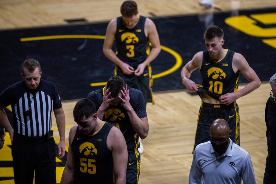 The Iowa men's basketball team walks to the locker room after a men's basketball game between the Iowa Hawkeyes and the Ohio State Buckeyes at Carver-Hawkeye Arena on Thursday, Feb. 4, 2021. The Buckeyes defeated the Hawkeyes in a close game, 89-85.
