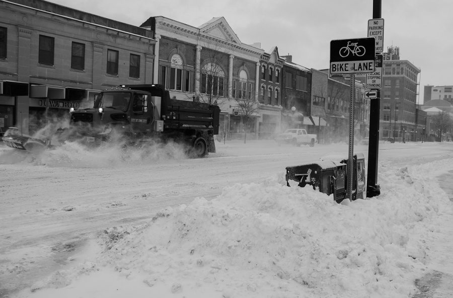 A snow plow shovels snow on Clinton Street in Iowa City on Thursday, Feb. 4, 2021. A winter storm warning was issued for eastern Iowa.