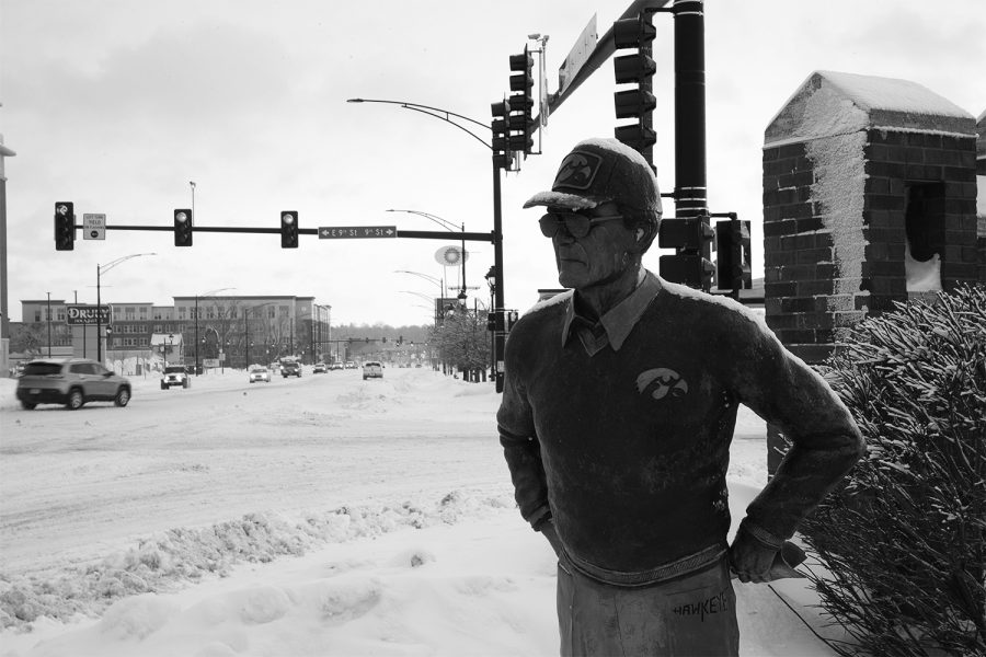 The Hayden Fry Statue covered in snow on Hayden Fry Way and Iowa River Landing is seen on February 4 2021.