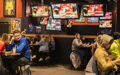 Tables are kept 6 feet apart at Buffalo Wild Wings during the Super Bowl on Sunday, Feb. 7, 2021. Social distancing is still maintained after Governor Kim Reynolds removed the mandate at 12:01 a.m. that morning.  (Jeff Sigmund/Daily Iowan)