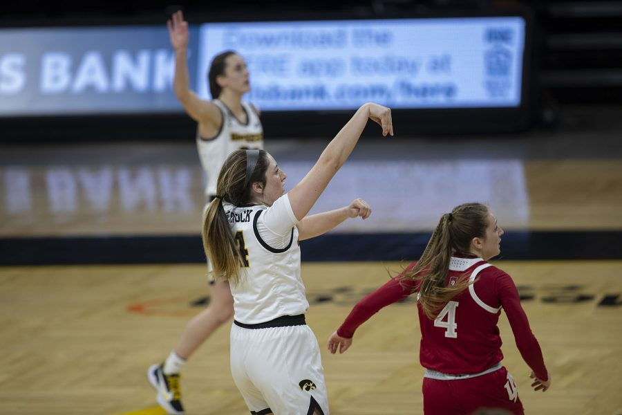 McKenna Warnock shoots a three pointer at the Iowa Women's Basketball game against Indiana on Sunday, Feb. 7, 2021, at Carver Hawkeye Arena. Indiana defeated Iowa 85-72.