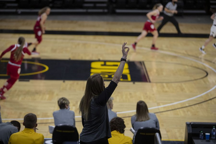 A member of the team celebrates a basket during the Iowa Women's Basketball game against Indiana at Carver Hawkeye Arena on Sunday, Feb. 7, 2021.