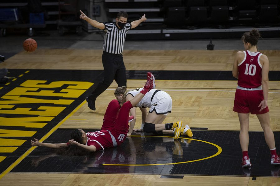 Both Iowa and Indiana chase after the ball during the Iowa Women's Basketball game against Indiana at Carver Hawkeye Arena on Sunday, Feb. 7, 2021. Indiana defeated Iowa 85-72.