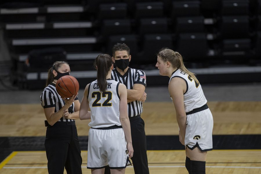 Iowa's players Caitlin Clark and Monika Czinano discuss a play with the referees at the Iowa Women's Basketball game against Indiana at Carver Hawkeye Arena on Sunday, Feb. 7, 2021.