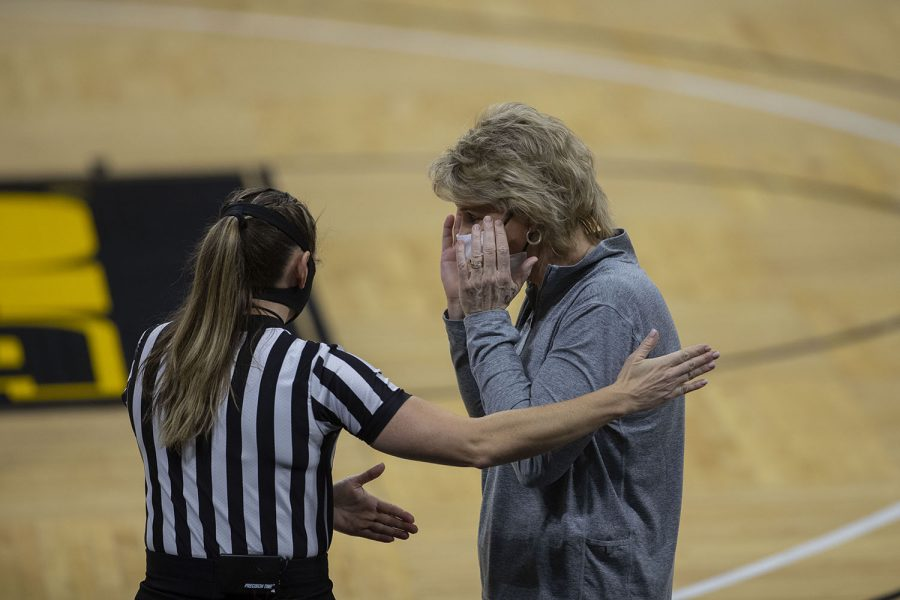 A referee discusses a play with Iowa coach Lisa Bluder during the Iowa Women's Basketball game against Indiana at Carver Hawkeye Arena on Sunday, Feb. 7, 2021. Indiana defeated Iowa 85-72.