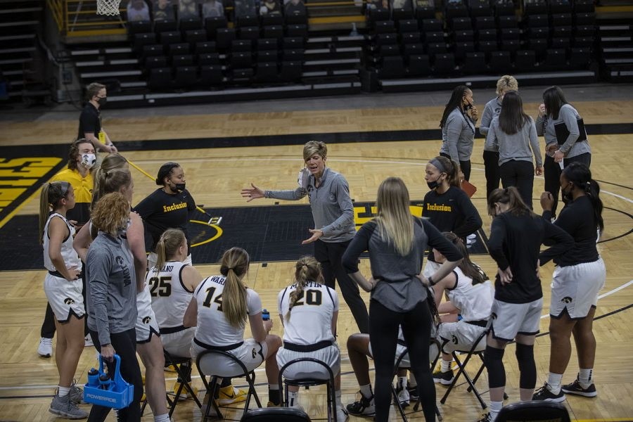 The Iowa Hawkeyes huddle up during a timeout at the Iowa Women's Basketball game against Indiana on Sunday, Feb. 7, 2021, at Carver Hawkeye Arena. Indiana defeated Iowa 85-72.