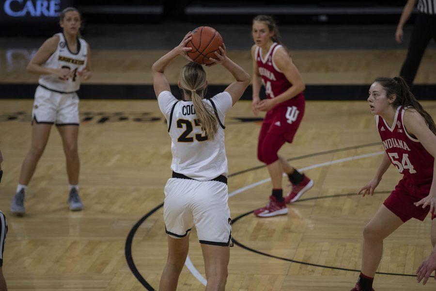 Logan Cook looks to pass the ball at the Iowa Women's Basketball game against Indiana on Sunday, Feb. 7, 2021, at Carver Hawkeye Arena. Indiana defeated Iowa 85-72.