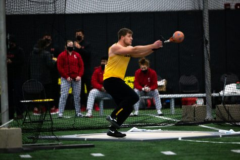 Iowa Weight Thrower Tyler Lienau winds up to throw. Lienau finished second with his best throw on the day going 20.68 meters at the Hawkeye B1G Invitational track and field meet at the University of Iowa Hawkeye Tennis and Recreation Complex on Saturday, Feb. 13 , 2021.