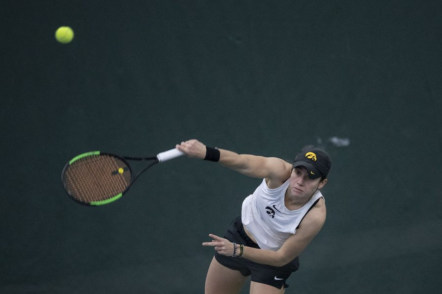 Iowa's Elise Van Heuvelen Treadwell hits the ball during the Iowa women's tennis meet v. Northwestern in the Hawkeye Tennis and Recreation Complex on Sunday, Feb. 14, 2021. Northwestern defeated Iowa with a score of 6-1.