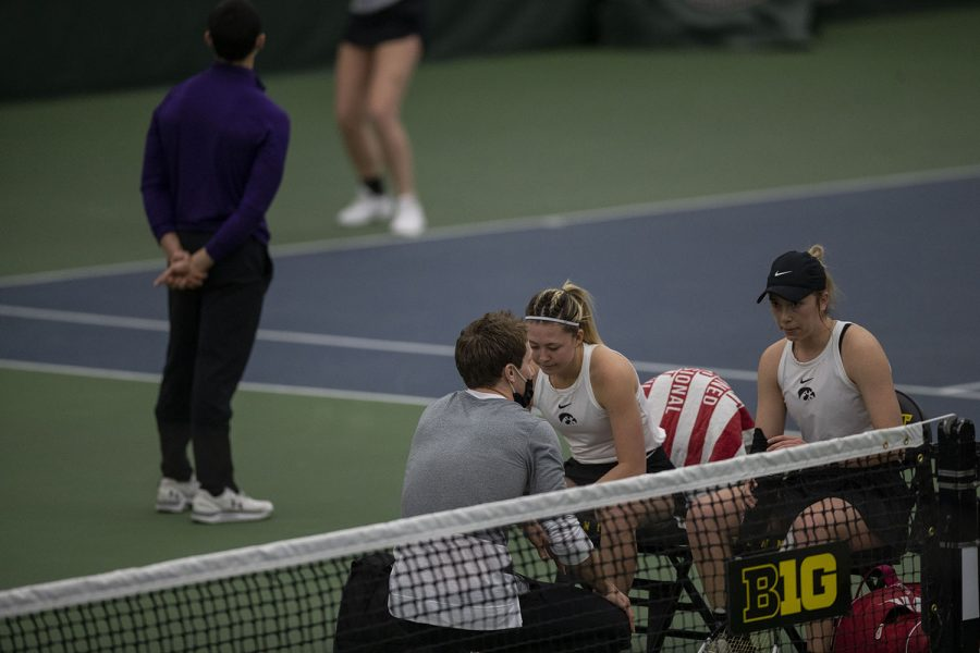 Doubles+pair+Alexa+Noel+%28left%29+and+Samantha+Mannix+%28right%29+sit+with+a+coach+during+the+Iowa+women%E2%80%99s+tennis+meet+v.+Northwestern+in+the+Hawkeye+Tennis+and+Recreation+Complex+on+Sunday%2C+Feb.+14%2C+2021.+Northwestern+defeated+Iowa+with+a+score+of+6-1.