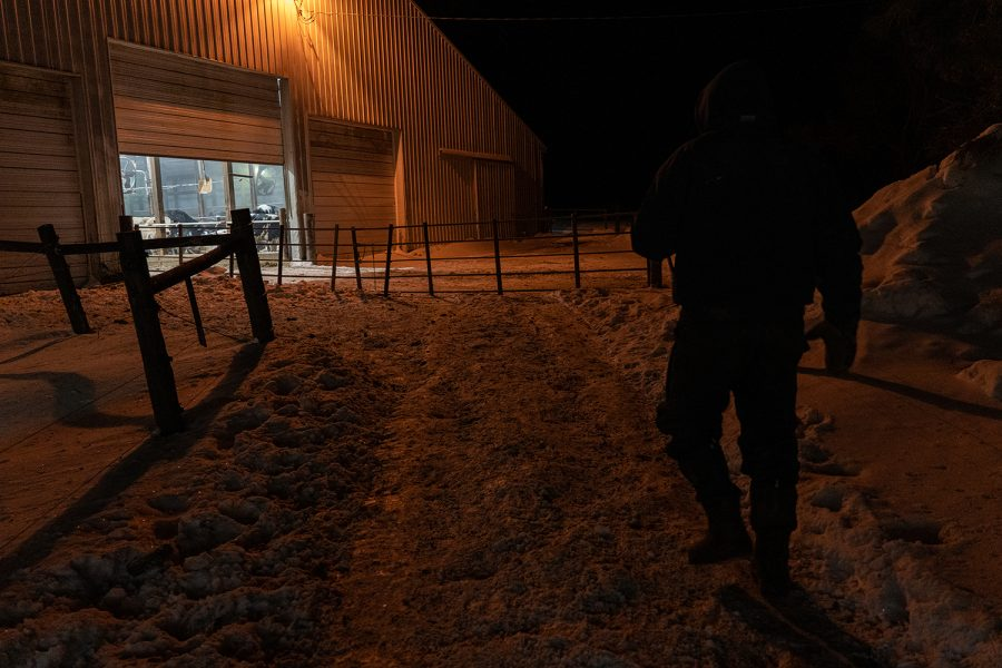 J. Schanbacher walks towards the barn to start moving cattle and to begin the milking process on his dairy farm in Atkins, IA. The day begins at 4:30am at Schanbacher Acres and it's -13 degrees at the start of Wednesday, February 17, 2021.