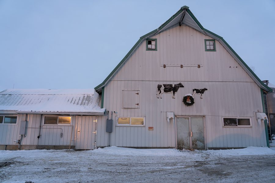 The front of the milking parlor is seen at Schanbacher Acres just after sunset on Wednesday, February 17, 2021. The work day is in full swing and the temperature won't rise above zero until close to noon.