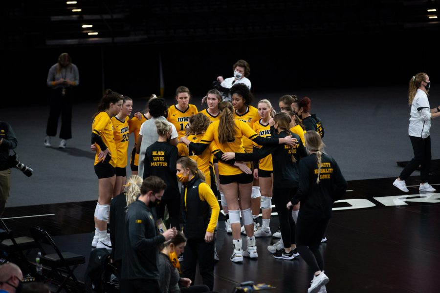 Iowa players huddle up before a women's volleyball match between Iowa and Rutgers at Xtream Arena on Saturday, Feb. 20, 2021. The Scarlet Knights defeated the Hawkeyes 3 sets to 2.