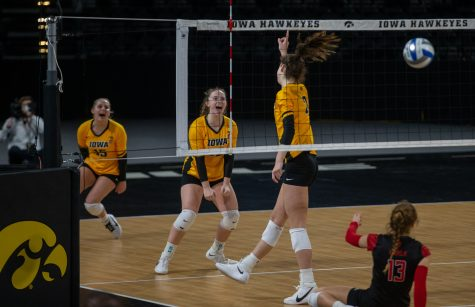 Iowa Setter Bailey Ortega celebrates a point following a kill from Outside Hitter Courtney Buzzerio during a women