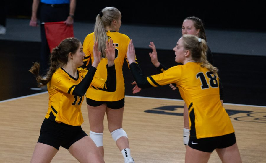 Iowa Middle Blockers Blythe Reints and Hannah Clayton high-five following a substitution during a women's volleyball match between Iowa and Rutgers at Xtream Arena on Saturday, Feb. 20, 2021. The Scarlet Knights defeated the Hawkeyes 3 sets to 2.