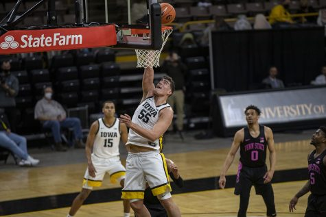 Iowa center Luka Garza shoots a record-breaking basket with eight minutes left of a men