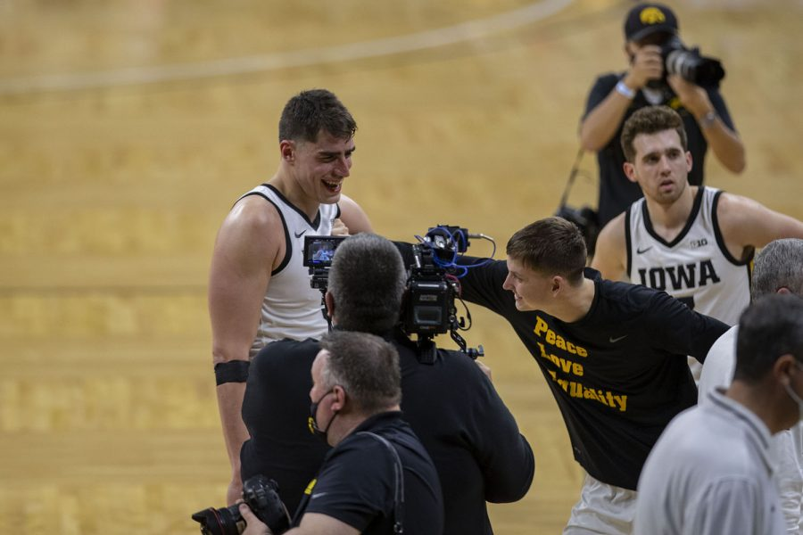 Iowa center Luka Garza celebrates breaking the record for Iowa's all-time leading scorer after a men's basketball game against Penn State on Sunday, Feb. 21, 2021 at Carver Hawkeye Arena. The Hawkeyes defeated the Nittany Lions, 74-68. Garza now has a career total of 2,126 points.