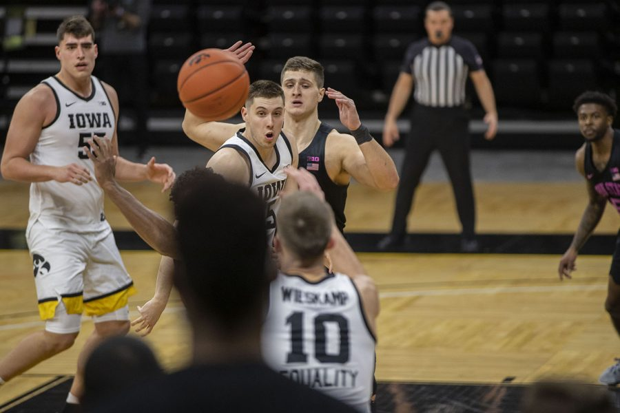 Iowa guard CJ Fredrick passes the ball during a men's basketball game against Penn State on Sunday, Feb. 21, 2021 at Carver Hawkeye Arena. The Hawkeyes defeated the Nittany Lions, 74-68. (Hannah Kinson/The Daily Iowan)