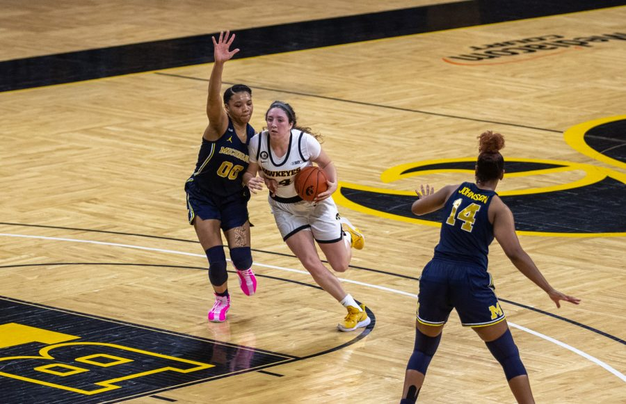 Iowa Forward McKenna Warnock drives to the basket  during a women's basketball game against Michigan on Thursday, Feb. 25, 2021 at Carver Hawkeye Arena. The Hawkeyes defeated the Wolverines 89-67.