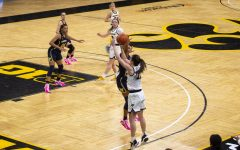 Iowa Guard Caitlin Clark releases from the corner during a women's basketball game against Michigan on Thursday, Feb. 25, 2021 at Carver Hawkeye Arena. The Hawkeyes defeated the Wolverines 89-67.