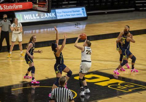Iowa Center Monika Czinano shoots in the paint during a women