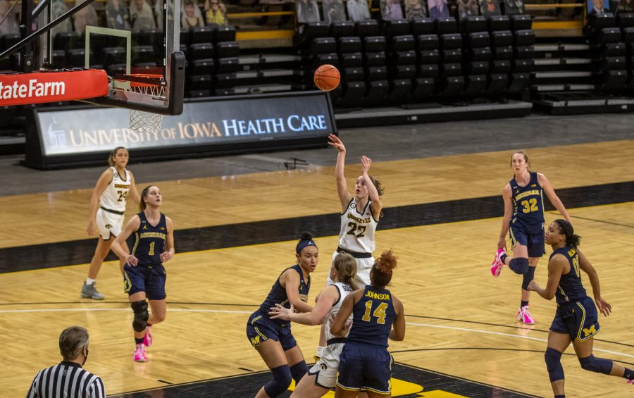 Iowa Guard Caitlin Clark pulls up in traffic during a women's basketball game against Michigan on Thursday, Feb. 25, 2021 at Carver Hawkeye Arena. The Hawkeyes defeated the Wolverines 89-67.