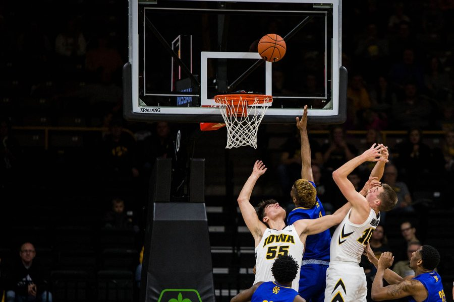 Iowa players jump for the rebound during Iowa's game against UMKC at Carver Hawkeye Arena on November 8, 2018. The Hawkeye defeated the Kangaroos 77-63. Garza played the opener of his sophomore year only a few weeks after undergoing surgery to remove a nine-pound cyst from his abdomen. (Megan Nagorzanski/The Daily Iowan)