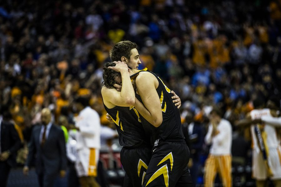 Iowa forward Nicholas Baer comforts forward Luka Garza after the loss against Tennessee in the NCAA Tournament on Sunday, March 24, 2019. The Volunteers defeated the Hawkeyes 83-77 in overtime.