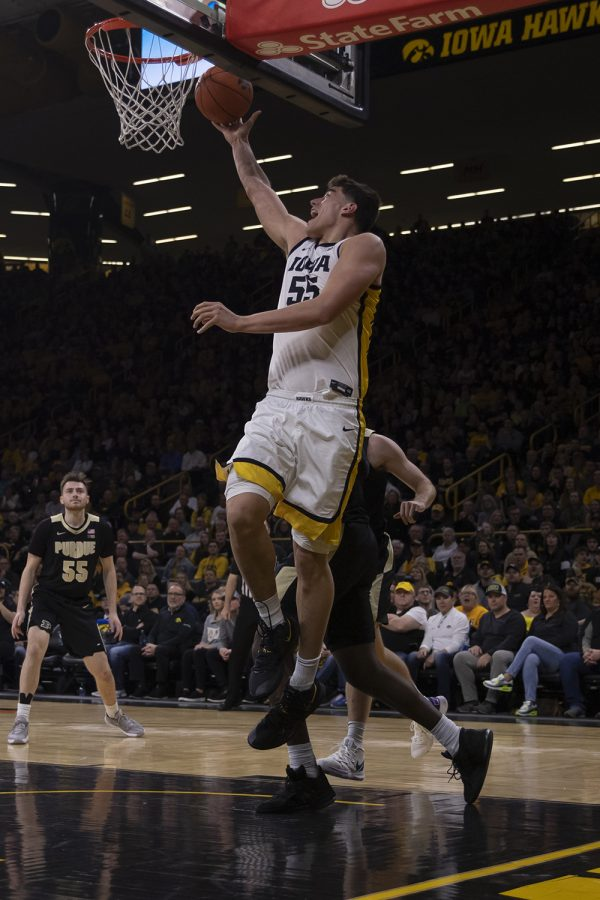 Iowa center Luka Garza shields the ball during a men's basketball game between Iowa and Purdue at Carver Hawkeye Arena on Tuesday, March 3, 2020. The Hawkeyes were defeated by the Boilermakers, 77-68. During this game Garza broke Iowa's single-season scoring record. (Hannah Kinson/The Daily Iowan)