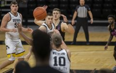 Iowa guard CJ Fredrick passes the ball during a men's basketball game against Penn State on Sunday, Feb. 21, 2021 at Carver Hawkeye Arena. The Hawkeyes defeated the Nittany Lions, 74-68.