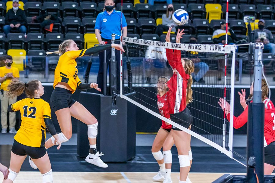 Iowa+Middle+Blocker+Hannah+Clayton+hits+the+ball+over+the+net+during+the+Iowa+Volleyball+game+against+Indiana+on+Feb.+6%2C+2021+at+Xtream+Arena.+Indiana+defeated+Iowa+3-2.+