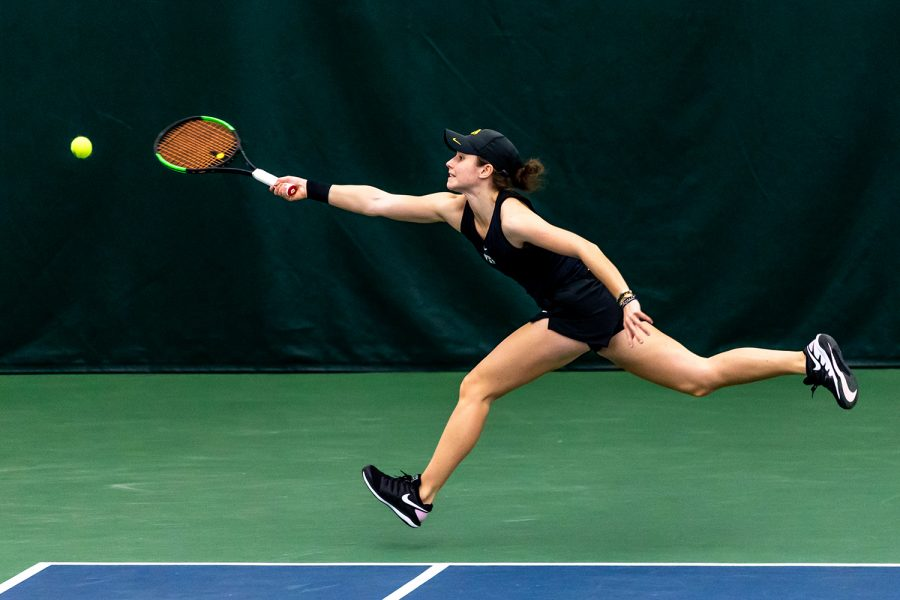 Iowa%E2%80%99s+Elise+van+Heuvelen+Treadwell+runs+to+hit+the+ball+over+the+net+during+the+Iowa+Women%E2%80%99s+Tennis+match+against+Purdue+on+Feb.+28%2C+2021+at+the+Hawkeye+Tennis+and+Recreation+Complex.+Iowa+defeated+Purdue+6-1.