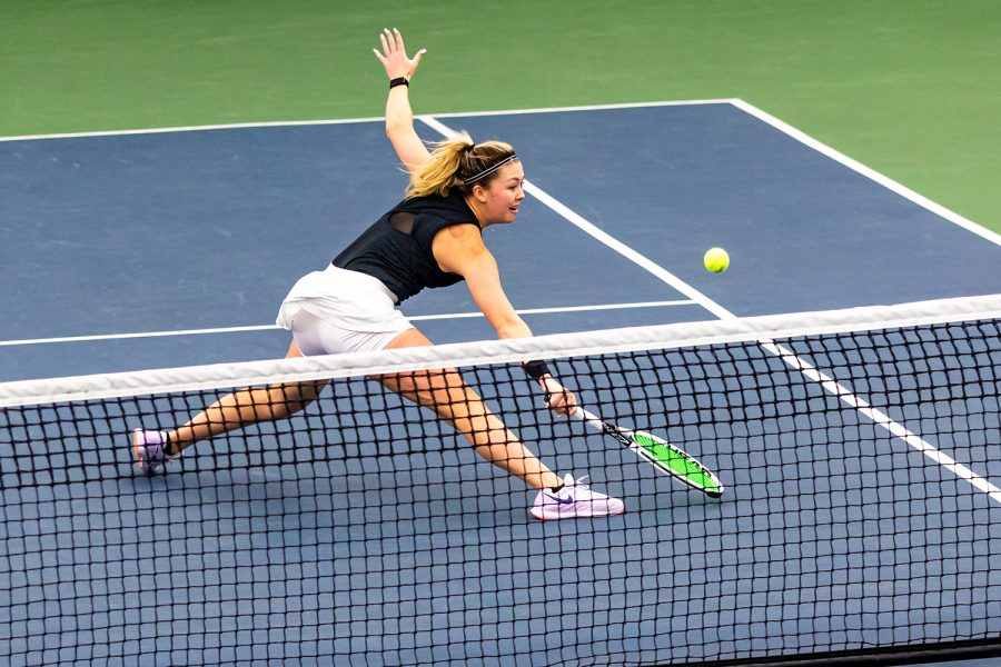 Iowa's Alexa Noel lunges to send the ball over the net during the Iowa Women's Tennis match against Purdue on Feb. 28, 2021 at the Hawkeye Tennis and Recreation Complex. Iowa defeated Purdue 6-1.