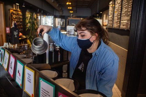 Barista Maizy Fugate makes a coffee in The Java House located on East Washington Street on Saturday, Feb. 27.