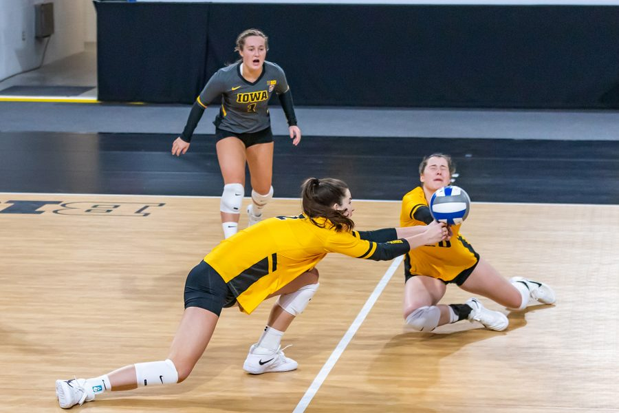 Iowa outside hitters Courtney Buzzerio and Edina Schmidt dive for the ball during the Iowa Volleyball game against Indiana on Feb. 6, 2021 at Xtream Arena. Indiana defeated Iowa 3-2.