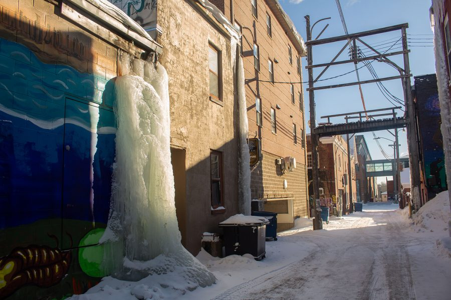 A tower of ice stands in an alley behind Elray's Live and Dive on Feb. 16 as temperatures drop below zero and aren't expected to rise above freezing until next week.