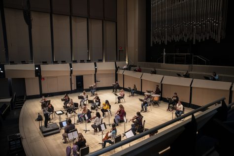 The University Orchestra, conducted by Megan Maddaleno, rehearses in the Voxman music building on Feb. 15, 2021.