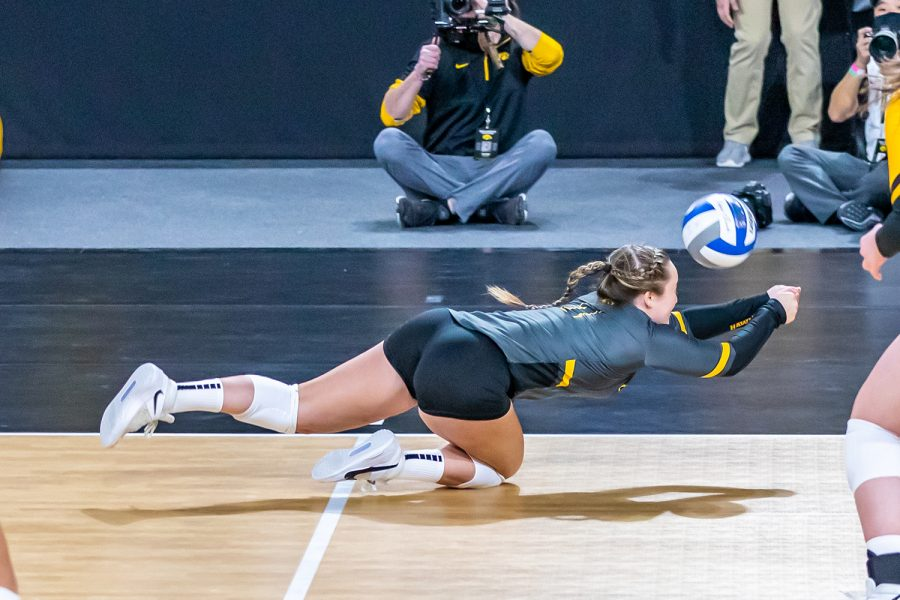 Iowa Defensive Specialist Joslyn Boyer dives for the ball during the Iowa Volleyball game against Indiana on Feb. 6, 2021 at Xtream Arena. Indiana defeated Iowa 3-2.