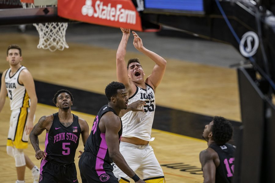 Sunday, Feb. 21, 2021; Iowa City, Iowa, USA; Iowa center Luka Garza (55) shoots a basket during the first half of a men's basketball game against Penn State on Sunday, Feb. 21, 2021 at Carver Hawkeye Arena. The Hawkeyes are down five points against the Nittany Lions, 36-41. At halftime Garza is two points away from breaking the record for Iowa's all-time leading scorer.
