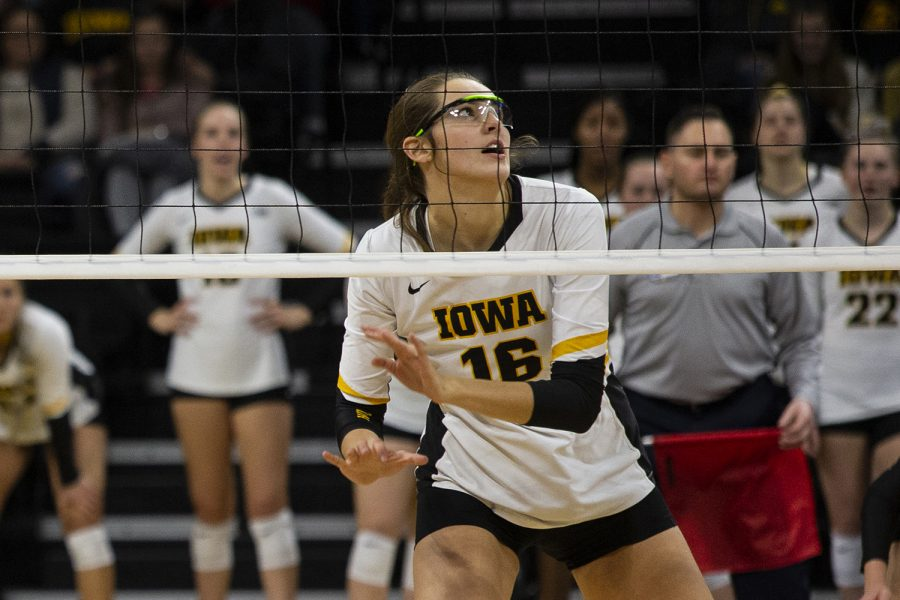 Middle blocker Grace Tubbs follows the ball during the Iowa and Nebraska volleyball game. The Huskers defeated the Hawkeyes in three sets on November 9, 2019, at Carver-Hawkeye Arena.