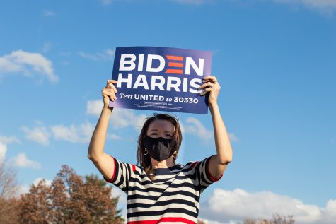 Christina Bohannan, Representative-Elect for the Iowa House of Representatives in District 85, holds a Biden-Harris sign in the air. Patrons celebrate the Biden Harris presidential victory in Mercer Park on Sunday. The event was hosted by Johnston County Supervisor RoyceAnn Porter. Patrons celebrate the Biden Harris presidential victory in Mercer Park on Sunday. The event was hosted by Johnston County Supervisor RoyceAnn Porter.