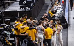 The Iowa men's gymnastics team huddles on Saturday, Feb. 20, 2022 during the Iowa vs. Penn State men's gymnastics meet at Carver-Hawkeye Arena. Iowa defeated Penn State 398.850-393.550. Men's gymnastics has not been reinstated like the women's swimming and diving team was earlier in February, so this is will be their final season.