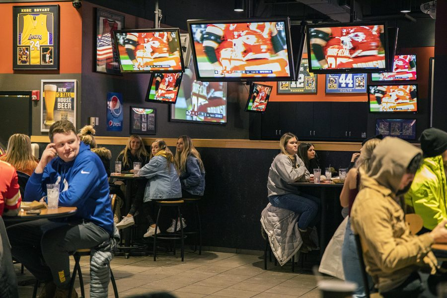 Tables are kept 6 feet apart at Buffalo Wild Wings during the Super Bowl on Sunday, Feb. 7, 2021. Social distancing is still maintained after Governor Kim Reynolds removed the mandate at 12:01 a.m. that morning.