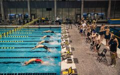 The men's medley relay is underway during a swim meet at the Campus Recreation and Wellness Center on Saturday, Jan. 16, 2021. The women's team hosted Nebraska while the men's team had an intrasquad scrimmage. (Shivansh Ahuja/The Daily Iowan)