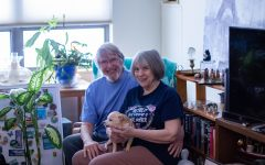 Warren Paris (left) and Jerri MacConnell (right) pose for a portrait with their dog, Ginger, at their Iowa City apartment on Feb 8, 2021. The pair got married in September after quarantining together during the COVID-19 pandemic. They met at a Write Your Life Story class at the Senior Center.
