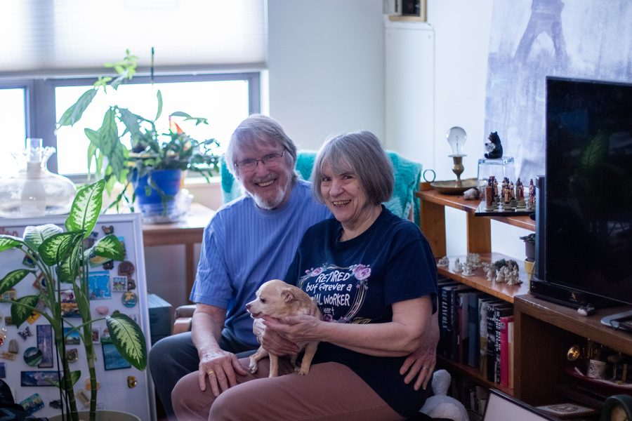 Warren+Paris+%28left%29+and+Jerri+MacConnell+%28right%29+pose+for+a+portrait+with+their+dog%2C+Ginger%2C+at+their+Iowa+City+apartment+on+Feb+8%2C+2021.+The+pair+got+married+in+September+after+quarantining+together+during+the+COVID-19+pandemic.+They+met+at+a+%22Write+Your+Life+Story%22+class+at+the+Senior+Center.+