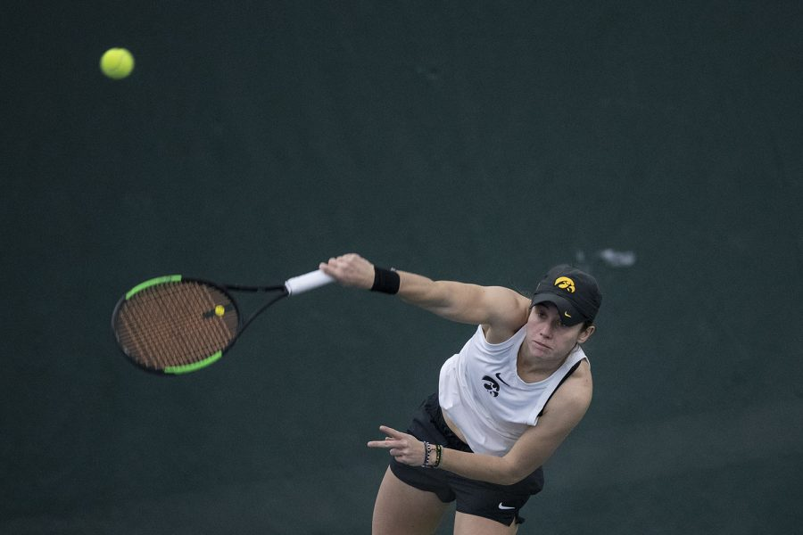 Iowa's Elise van Heuvelen Treadwell hits the ball during the Iowa women's tennis meet v. Northwestern in the Hawkeye Tennis and Recreation Complex on Sunday, Feb. 14, 2020. Northwestern defeated Iowa with a score of 6-1.