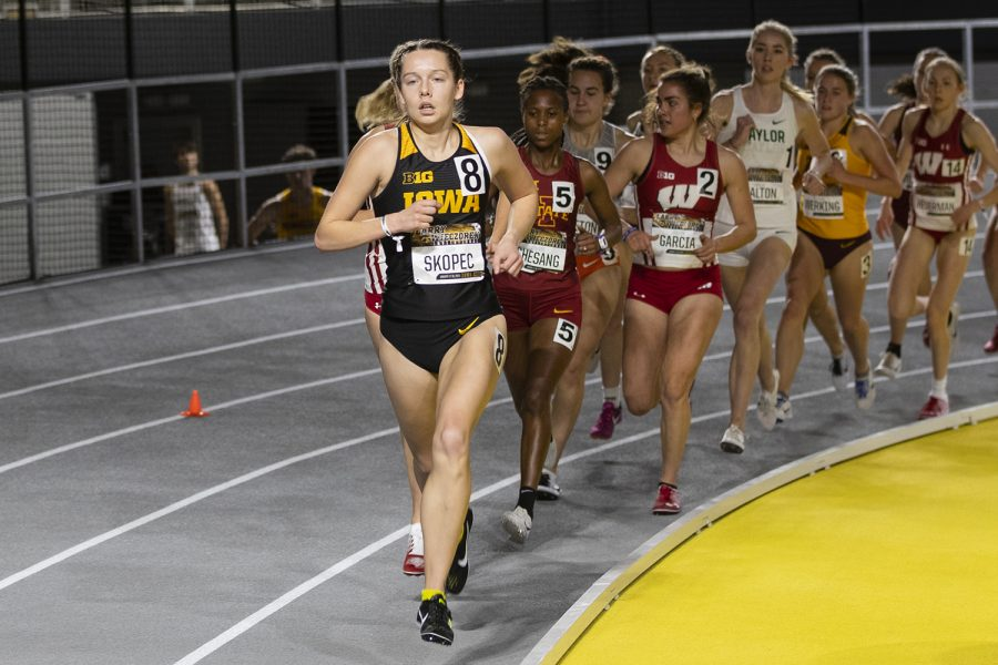 Iowa distance runner Gabby Skopec rounds the corner at the front of the pack in the women's 3000m run during the fourth annual Larry Wieczorek Invitational at the University of Iowa Recreation Building on Friday, Jan 17, 2020.